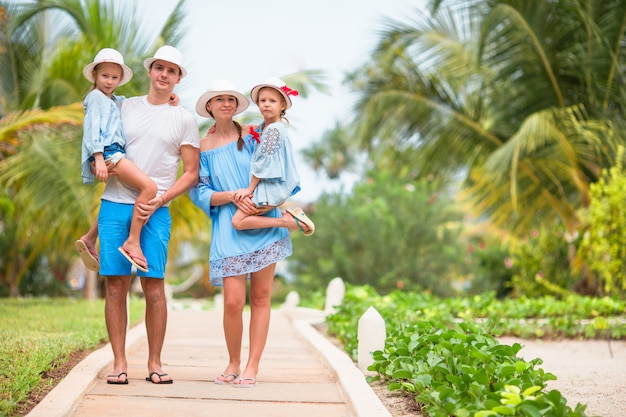 Happy family of four on vacation