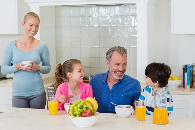 Happy family having breakfast in kitchen