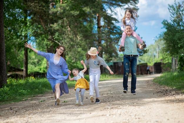 Happy family having fun on village road