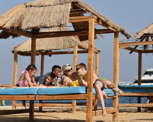 Happy family having a lunch on beach