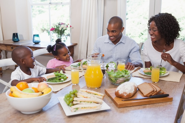 Happy family having lunch together Premium Photo