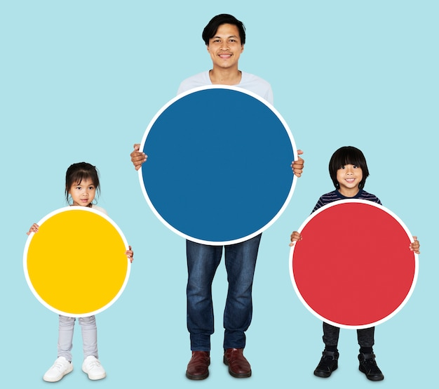 Happy family holding colorful round boards