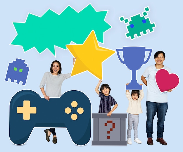 Happy family holding gaming icons