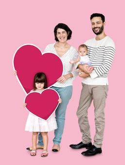 Happy family holding heart shaped icons