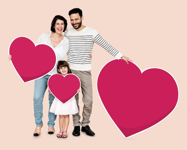 Happy family holding heart shaped icons