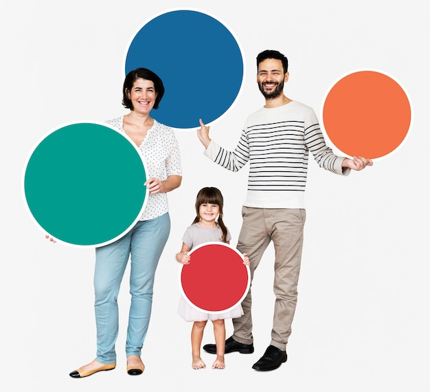 Happy family holding round colorful boards