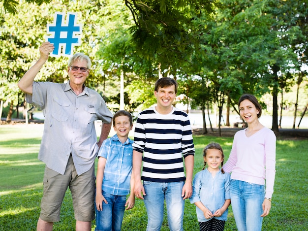 Happy family holding up hashtags