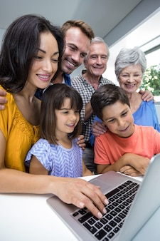 Happy family interacting using laptop