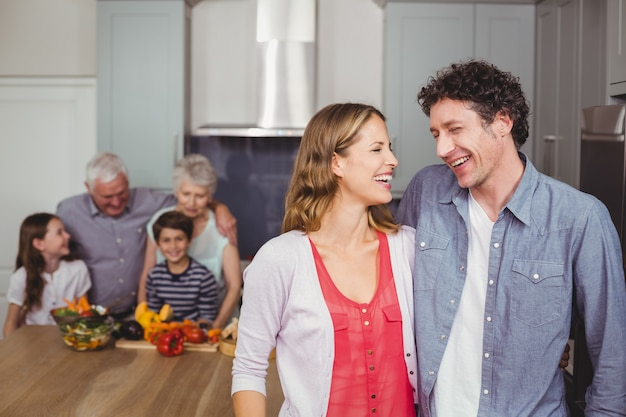 Happy family laughing in kitchen