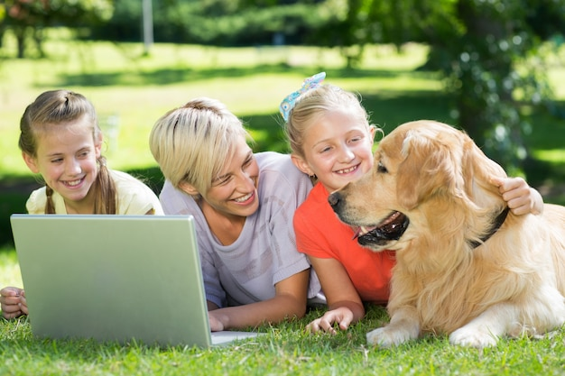Happy family looking at their dog