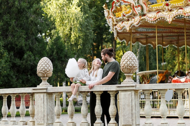 Happy family in the moonpark in the summer