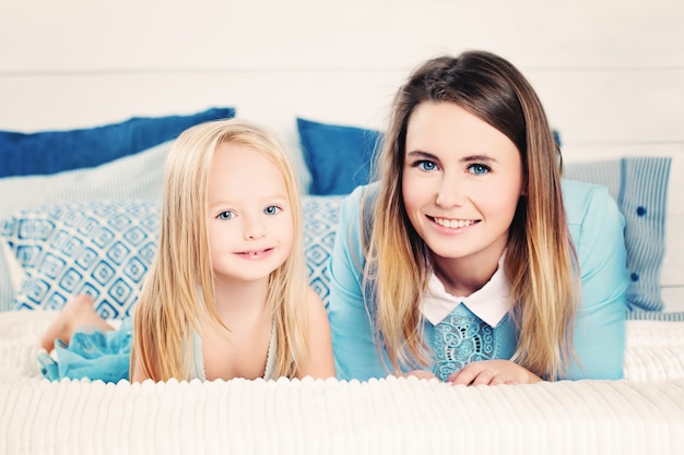 Happy family. mother and daughter at home