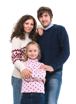 Happy family. mother, father and daughter posing on a white wall