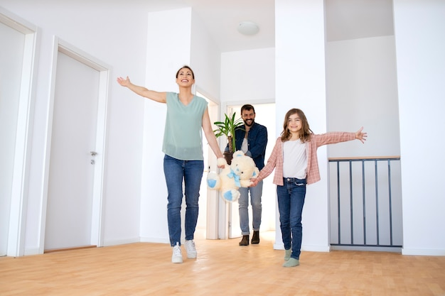 Happy family moving into new house.