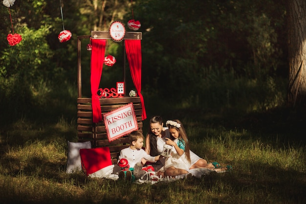 Happy family in nature photo shoot mother and children