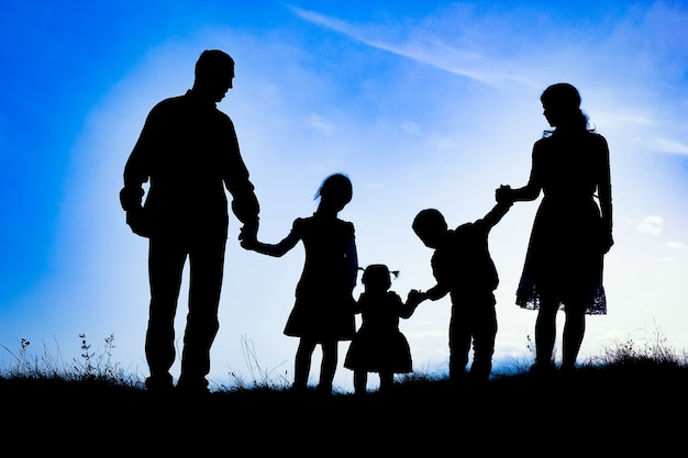 Happy family on nature silhouette
