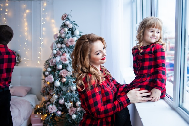 Happy family near christmas tree