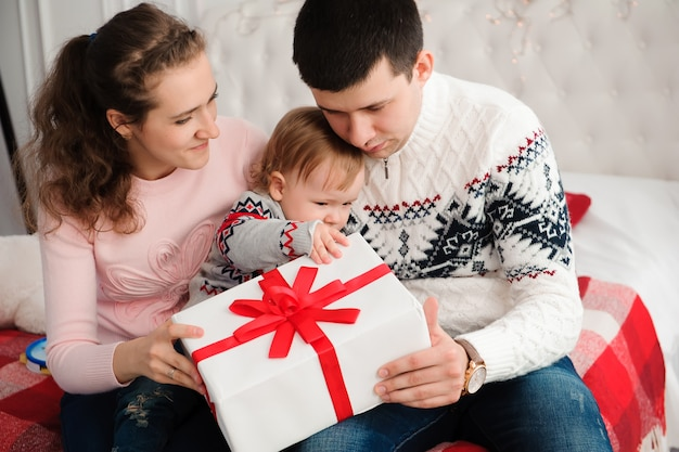 Happy family opening gift box.