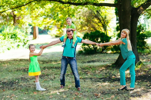 Happy family in the park. happiness.