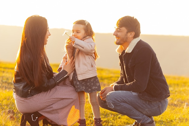 Happy family. photo of  family having time together in park or field