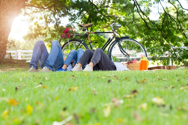 Happy family picnic lying in the garden togetherness relaxation concept