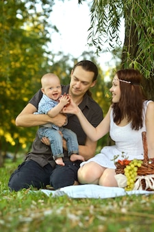 Happy family at the picnic in the park