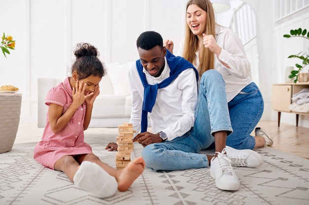 Happy family play game in living room