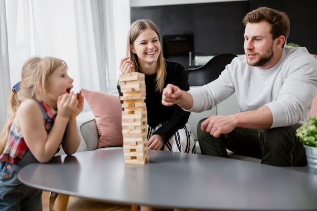 Happy family playing jenga