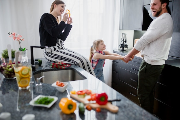 Happy family playing in kitchen