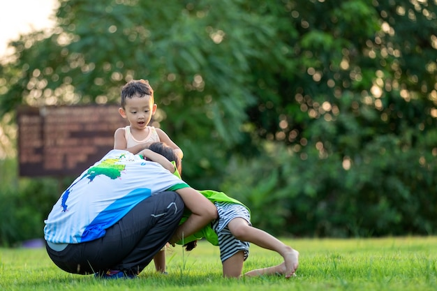 Happy family playing in the park. mother and son play together in nature in the summer