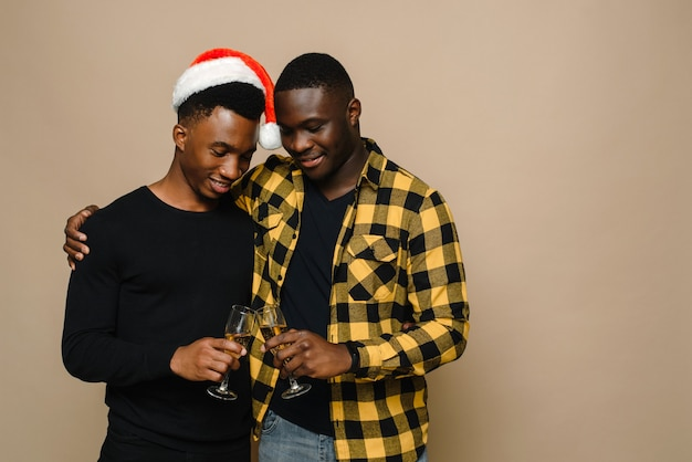 Happy family portrait on christmas, gay male couple on beige background.