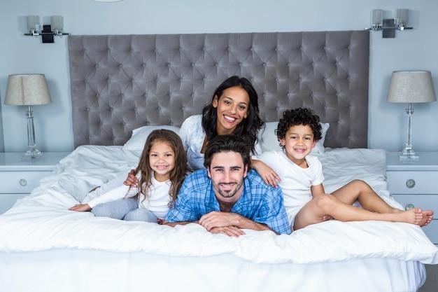 Happy family posing for camera