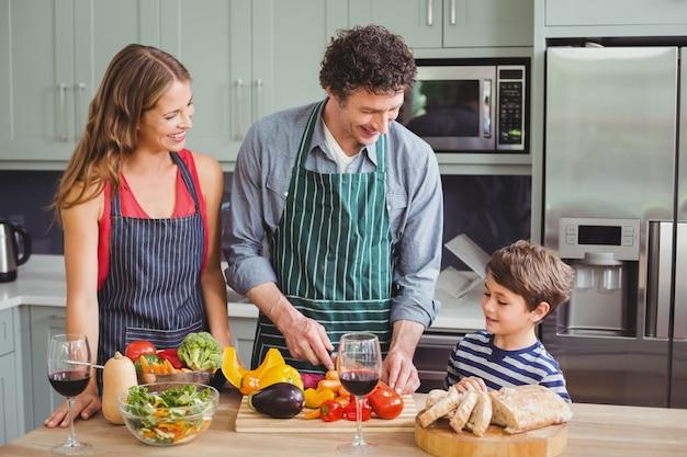 Happy family preparing a vegetable salad