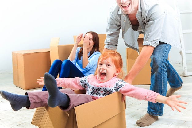 The happy family  at repair and relocation on a background of boxes