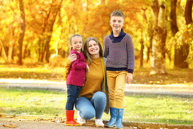 Happy family resting in autumn park