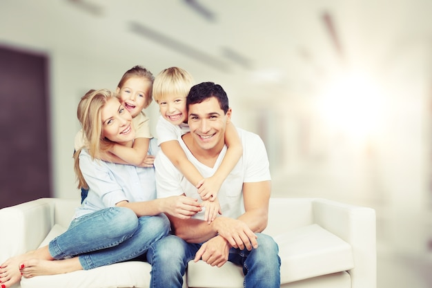 Happy family siting on sofa at home