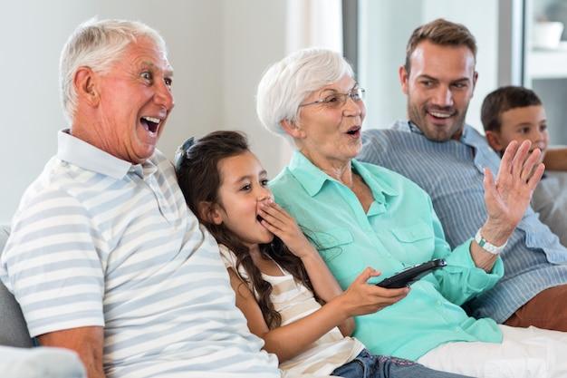 Happy family sitting on sofa