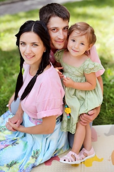 Happy family. smiling parents with their child.