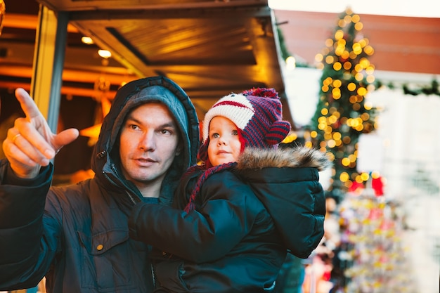 Happy family spend time at a christmas and new year holidays in the old town of klagenfurt austria