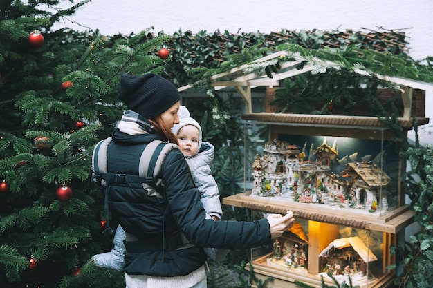 Happy family spend time at a christmas and new year holidays in the old town of salzburg austria