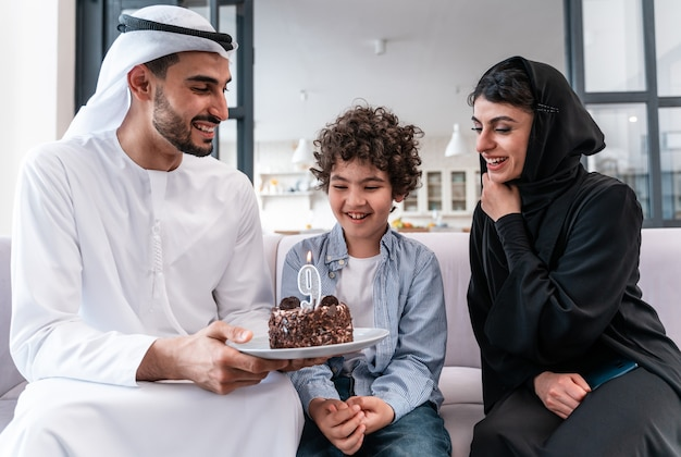 Happy family spending time together. arabian parents and kid celebrating his birthday together
