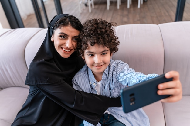 Happy family spending time together. arabian parents and kid lifestyle moments at home