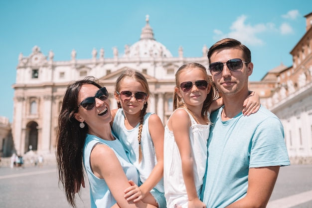 Happy family at st, peter's basilica church in vatican city,