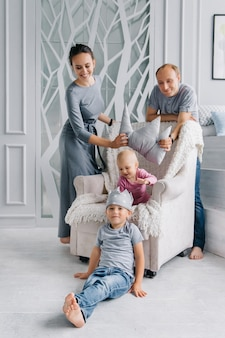 A happy family stays at home and tries on a crown for children , the concept of play and development in order to stay at home.