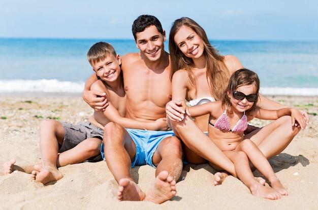 Happy family on vacations on beach