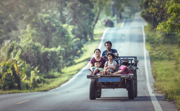 Happy family on a vehicle on the northeastern road of thailand