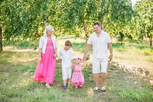Happy family walk in the summer in nature