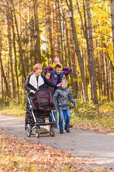 Happy family walking in autumn park