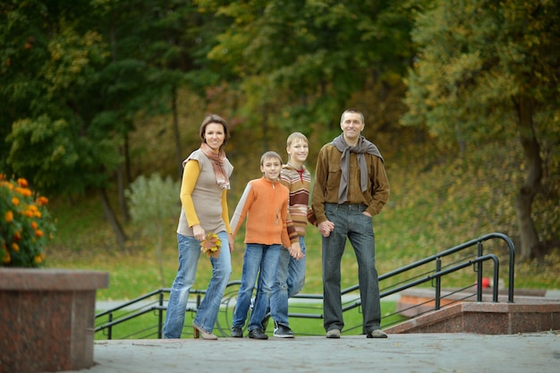 Happy family walking in the park on weekends