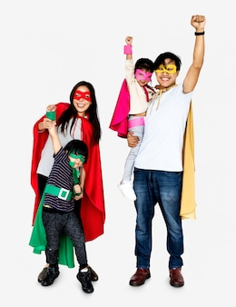 Happy family wearing superhero costumes